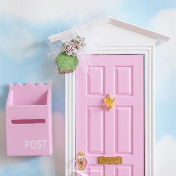 pink fairy door with grey flowers