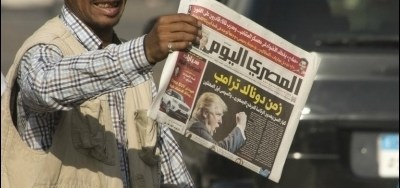 a-vendor-in-cairo-sells-newspapers-with-the-arabic-headline-donald-trump-era-on-november-10