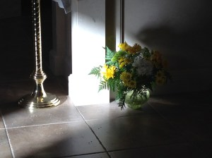 A stream of sunlight light makes subtle passes across the sanctuary....