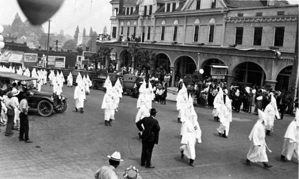 In 1922 the virulently anti-Catholic Ku Klux Klan was a powerful force in the Pacific Northwest as seen here in this photo of Klan members parading in the Southern Oregon town of Ashland.