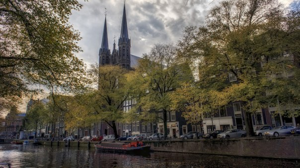 The Krijtberg Church sits among old merchant houses along an Amsterdam canal. in the heart of the city's business district.