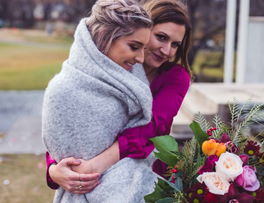 Millbrook resort winter wedding secret garden ceremony bouquet hug