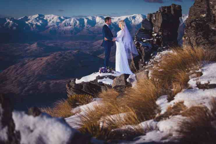 Queenstown destination elopement Cecil Peak snowy helicopter bride groom
