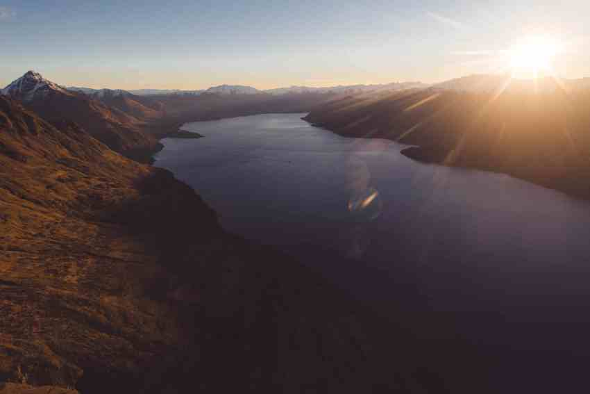 Queenstown heli wedding destination elopement Cecil Peak helicopter sunset