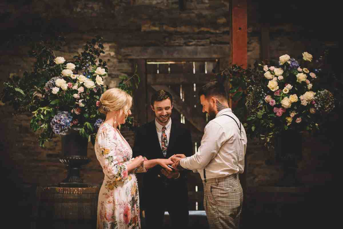 Nick & Nina's Thurlby Domain Elopement old stone stables wedding ceremony exchanging rings