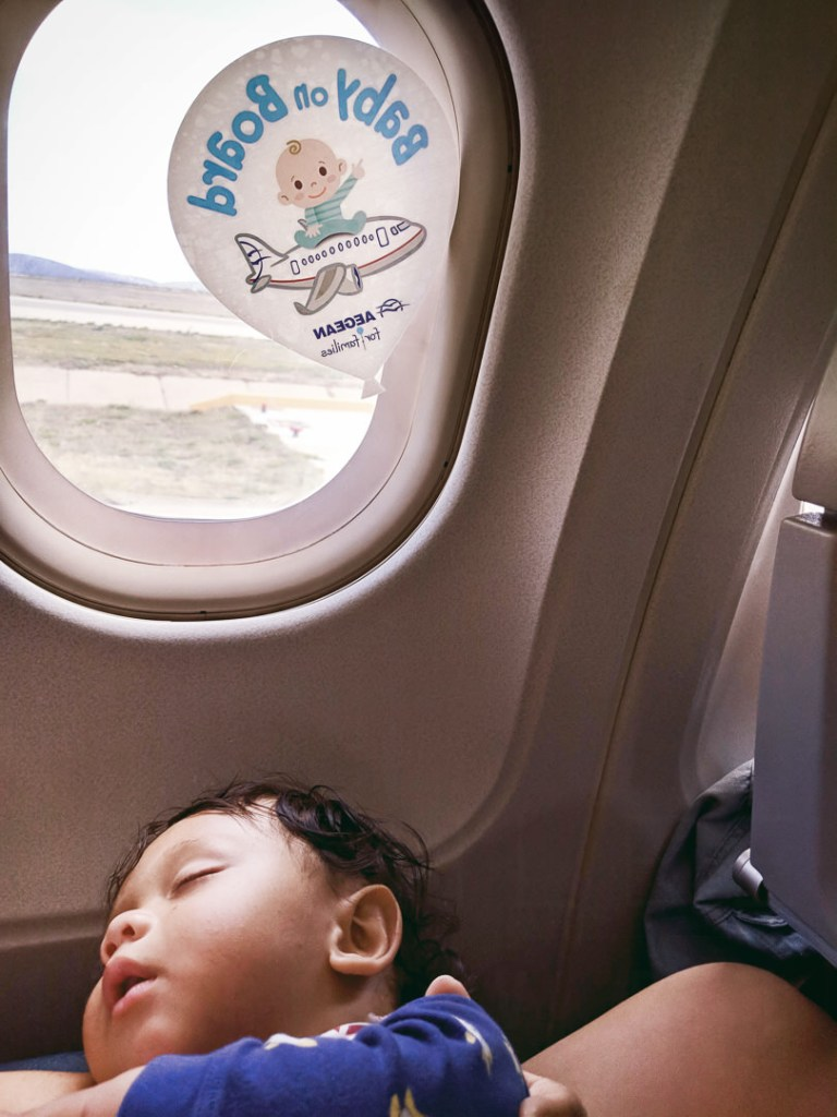 Sleeping baby on a plane post-strategic stopover