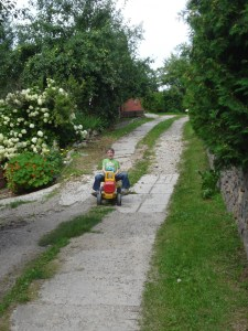 """Janis playing on the """"road"""" of the settlement down the drive of our hosts."""
