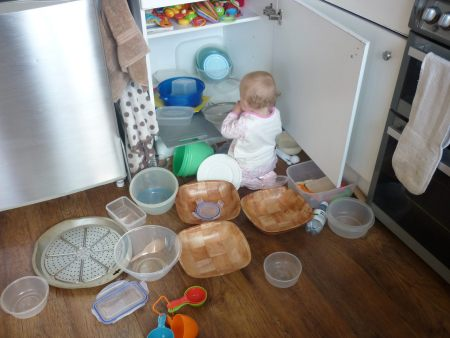 Family Clan Blog Olivia-emptying-her-cupboard