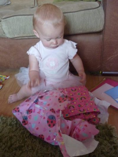 Family Clan Blog Olivia open her bday presents Birthday Girl Family Clan Blog