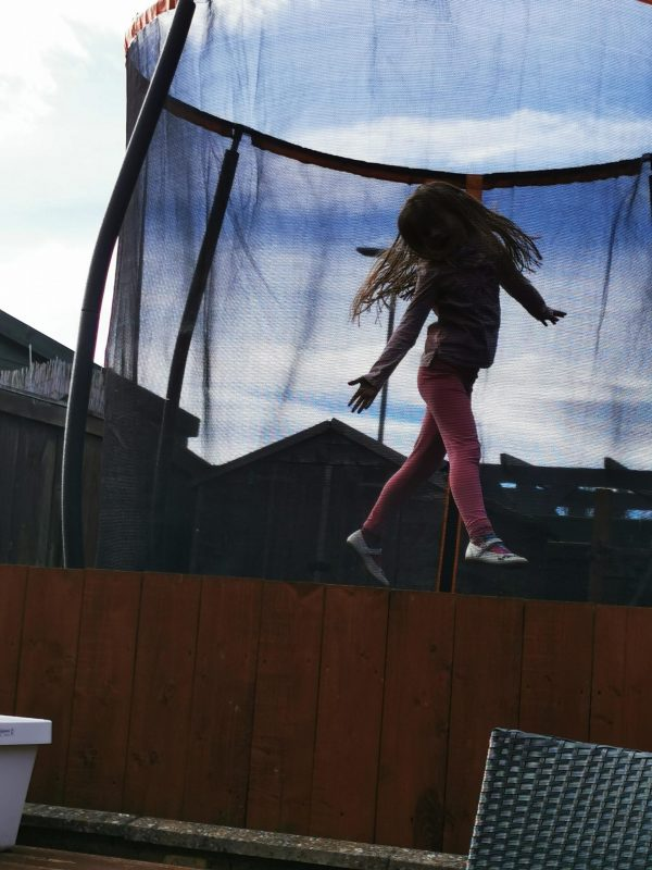 Grace jumping on the trampoline