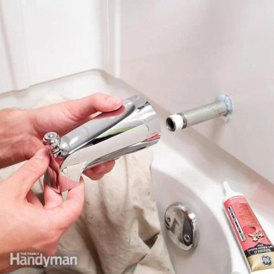 How to Replace a Bathtub Spout   The Family Handyman FH06FEB BATHSP 05 4 shower diverter repair  bathtub faucet repair  tub  spout diverter  how  Replacing a