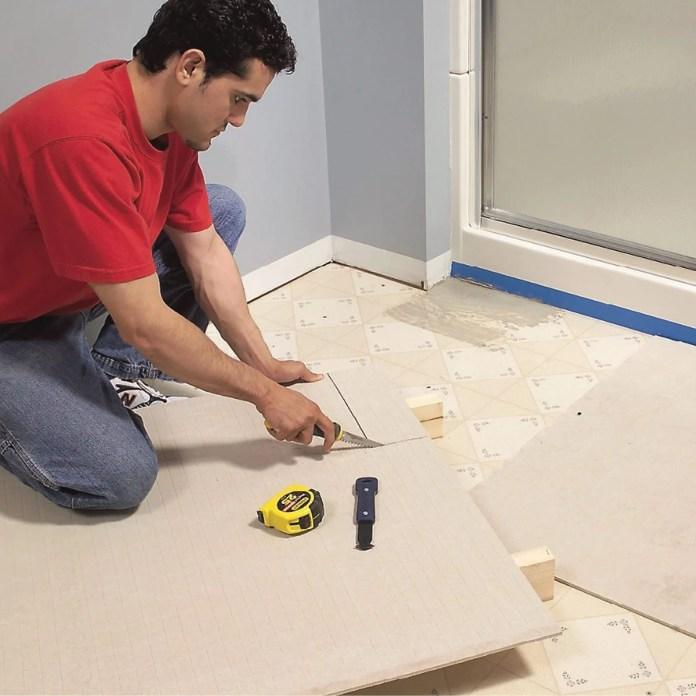 https www familyhandyman com project install a ceramic tile floor in the bathroom
