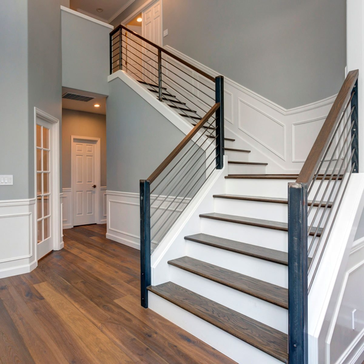 10 Ways To Freshen Up Outdated Banisters Family Handyman | Glass And Chrome Staircase | Contemporary | White Post | Single Spine | Lights | Stainless Steel