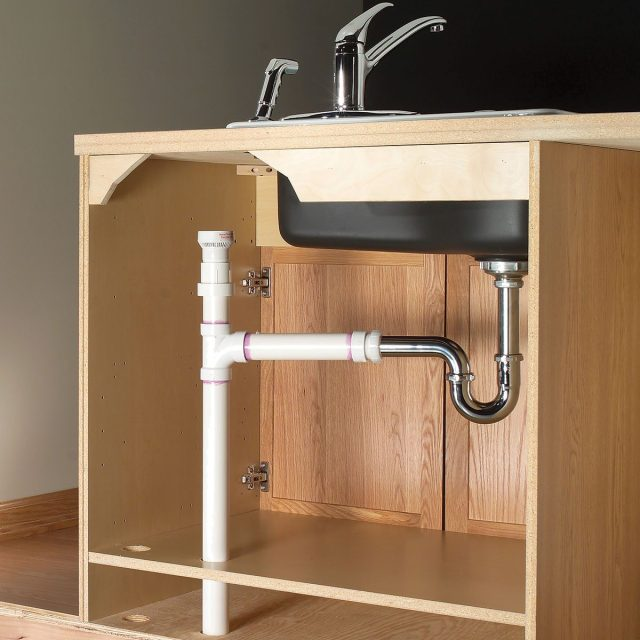 two ways to plumb an island sink