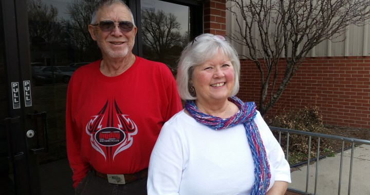 Volunteer couple poses for camera