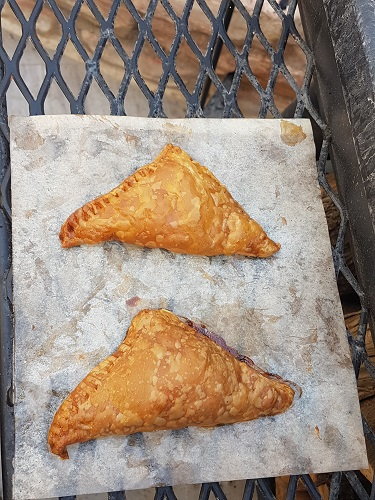 Apple turnovers coming out of the smoker