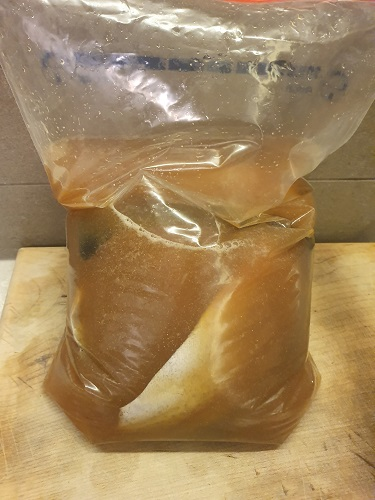 Trout in brine within a ziplock bag