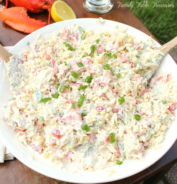 Orzo Pasta Salad in serving dish tossed with the creamy lemon dressing
