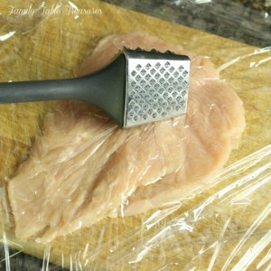 demonstration of how to use a meat tenderizer on breast
