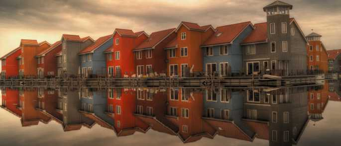 sea houses cloudy buildings 700x300 - We treat our clients like family.