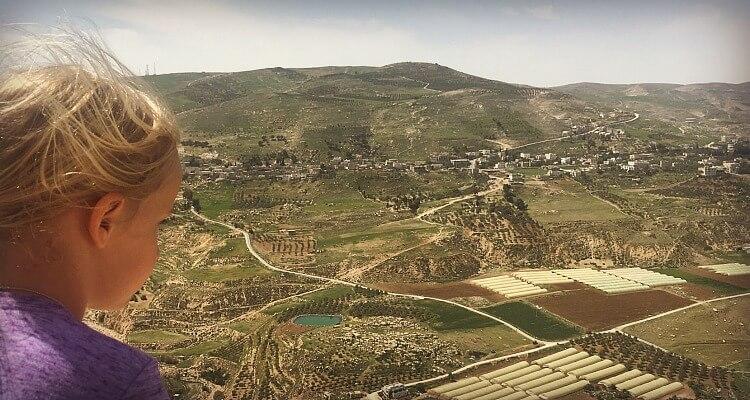 Child overlooking the landscape from Karak Castle Jordan