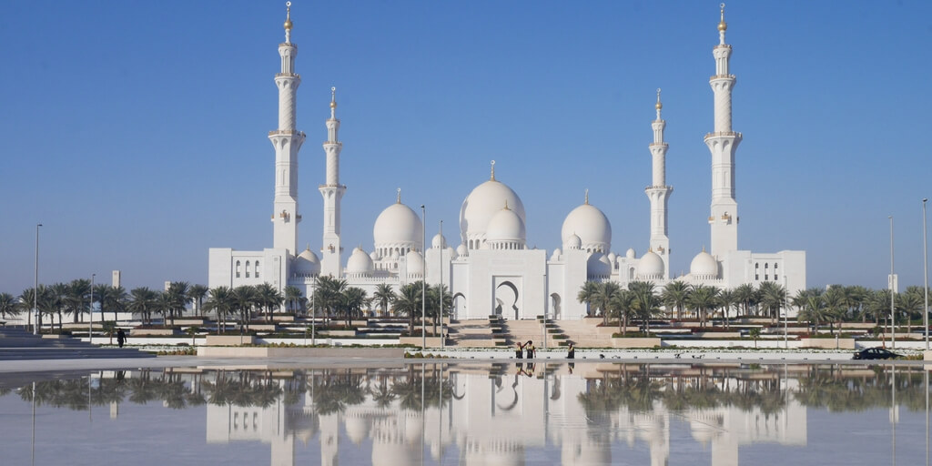Sheikh Zayed Grand Mosque reflective view over Wahat al Karama