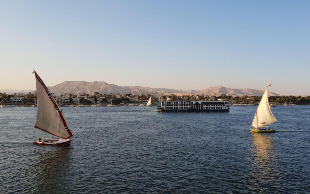 Nile cruise boat with feluccas