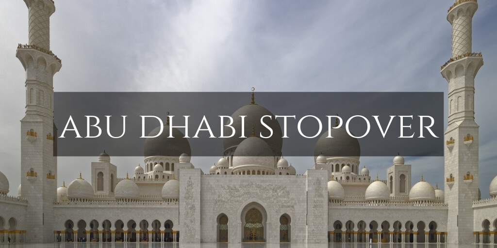 Abu Dhabi Stopover text overlay on the Grand Mosque