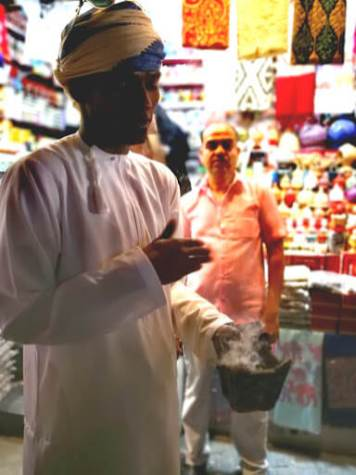Al Muttrah Souk Muscat salesman at work