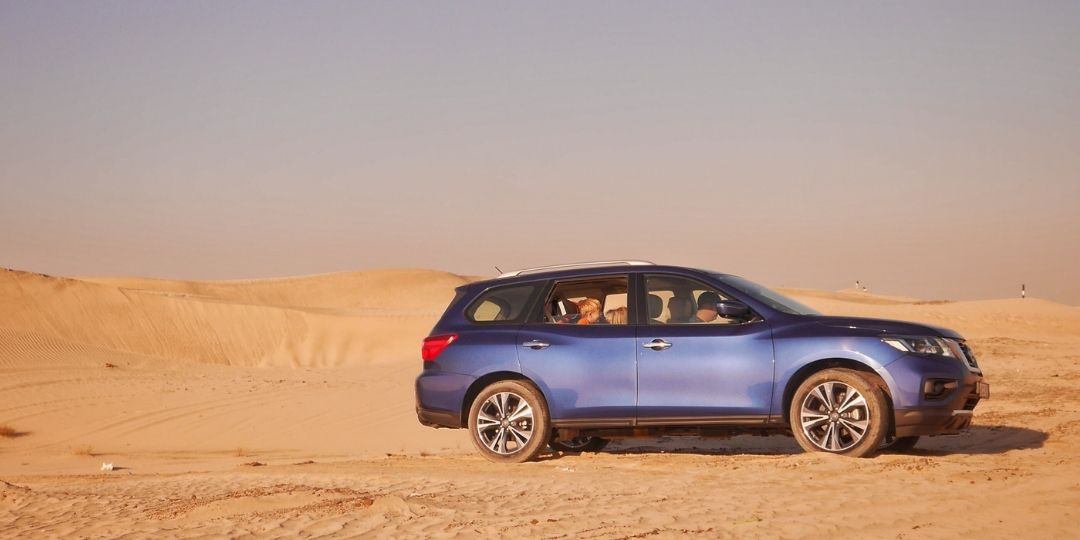Nissan Pathfinder driving in UAE Desert