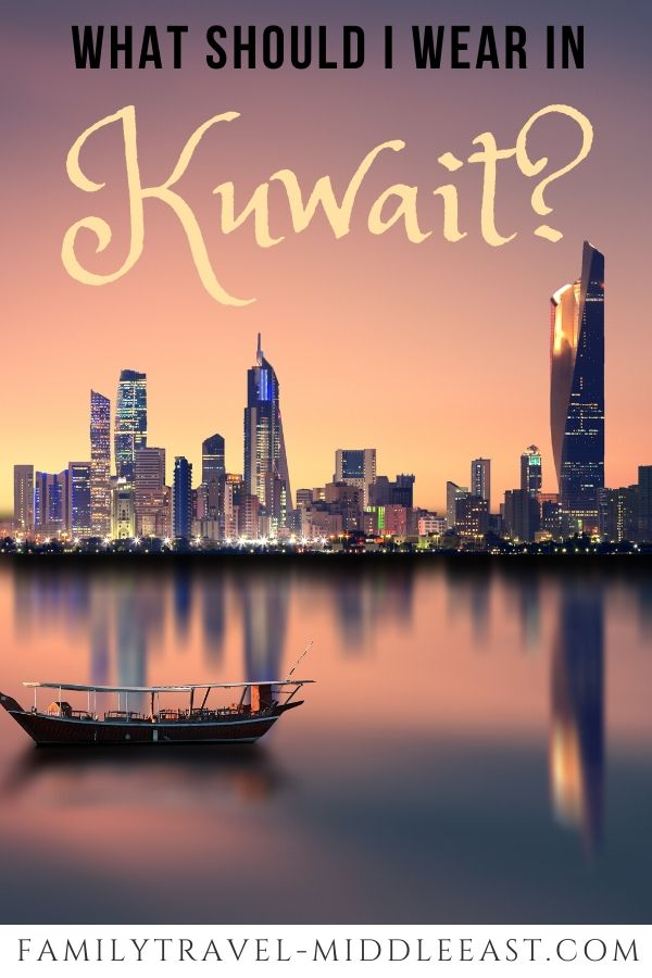 Kuwait what to wear over cityskline and tradtional dhow