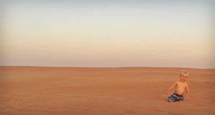 Small child in the Liwa Desert UAE