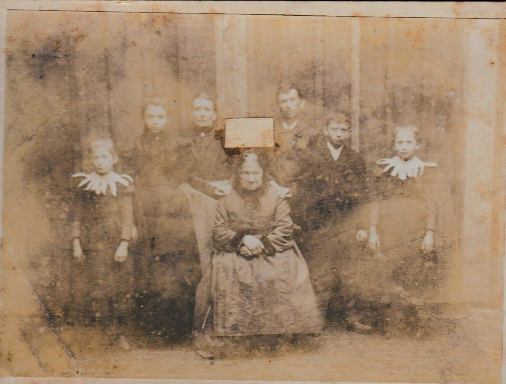 An Old Family Photo With Someone S Face Cut Out