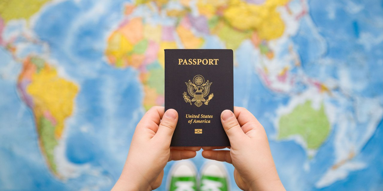 Child Holding Passport; Courtesy of goodmoments/Shutterstock.com