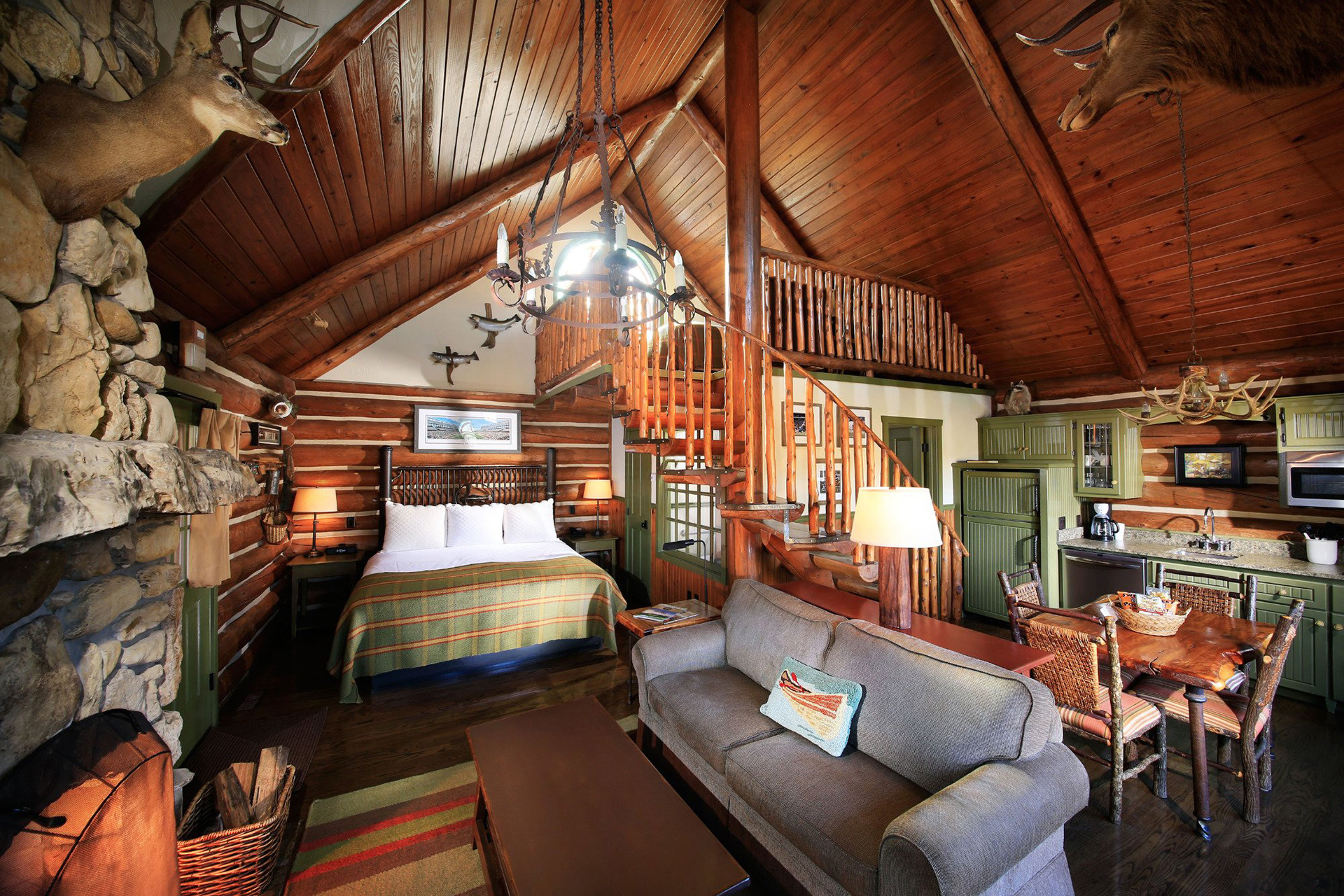 Private one bedroom with loft log cabin interior; Courtesy of Big Cedar Lodge