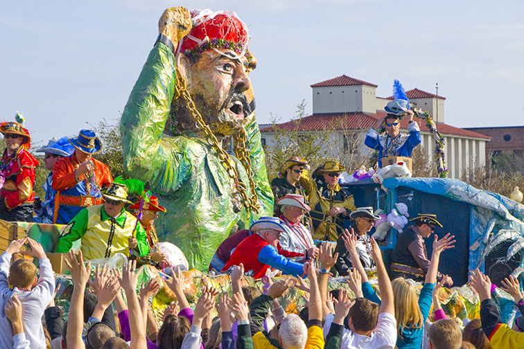 Revelers beg for beads at the Grand Mardi Gras parade in Pensacola; Courtesy of Cheryl Casey/Shutterstock
