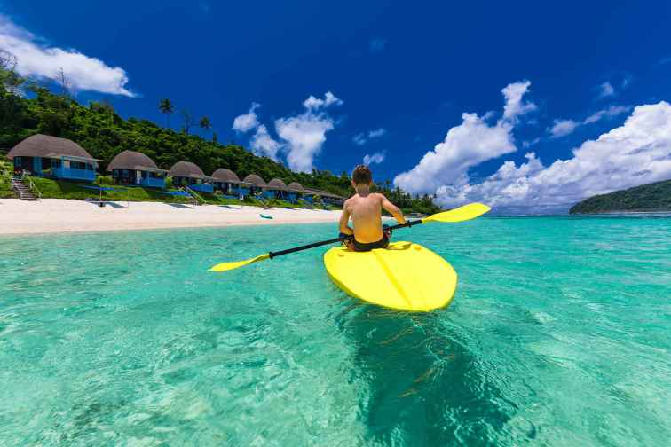 Boy Paddleboards in Fiji