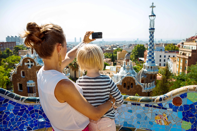Barcelona, Spain mom and son taking photo; Courtesy Alliance Images/Shutterstock