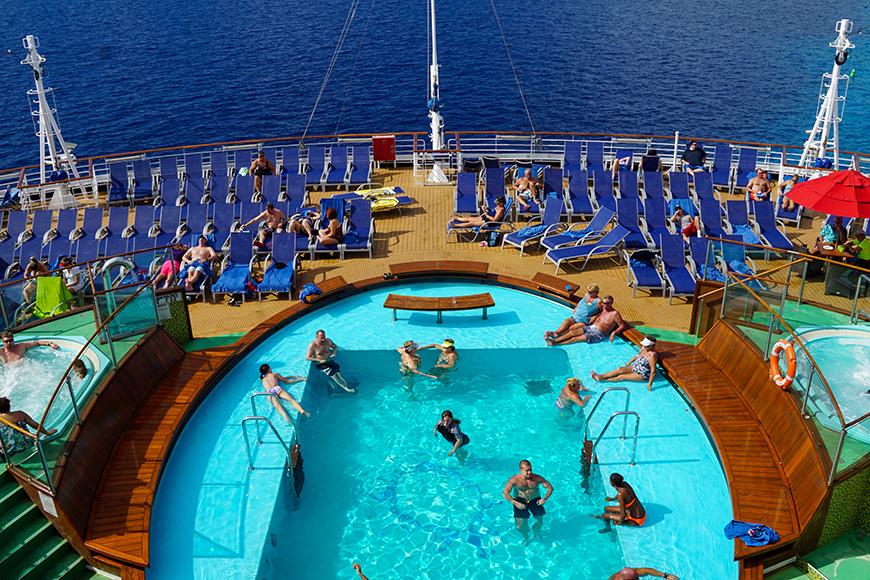 Poolside on the Carnival Breeze docked in Miami, Florida,; Courtesy of Ritu Manoj Jethani/Shutterstock