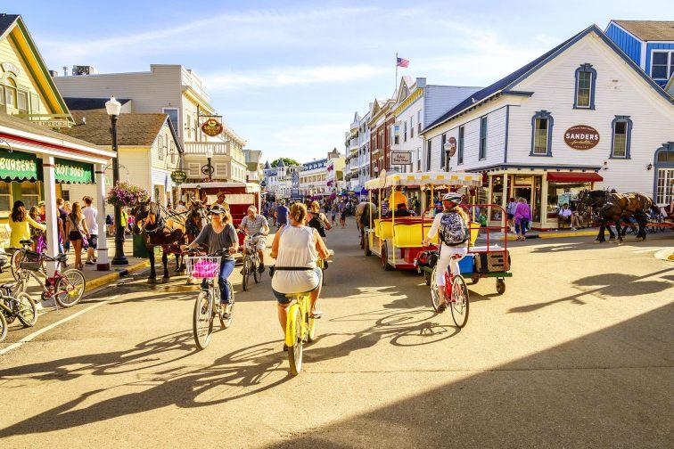 Families biking around Mackinac Island in Michigan; Courtesy of Alexey Stiop/Shutterstock.com