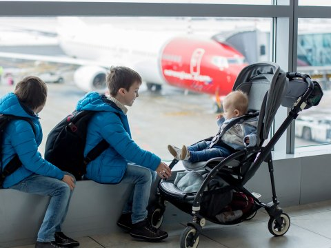 Kids with Stroller at Airport; Courtesy of Tomsickova Tatyana/Shutterstock.com