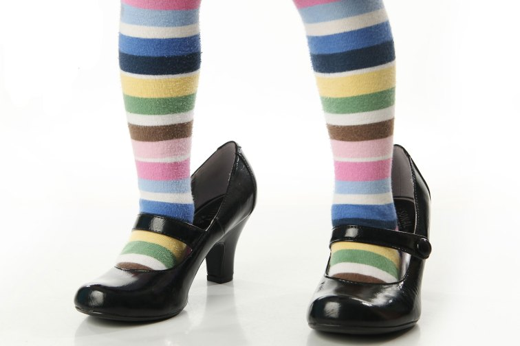 Child Wearing Parent's High Heels; Courtesy of blessings/Shutterstock.com