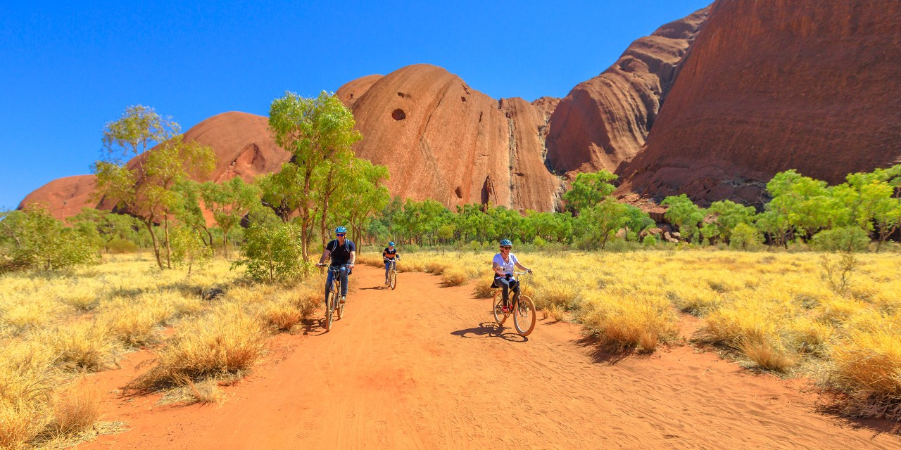 family discovery Ayers Rock with Outback Cycling Ride along Uluru Base Walk in Uluru-Kata Tjuta National Park; Courtesy of Benny Marty/Shutterstock