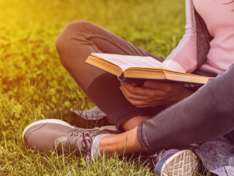 Teen girl reading book