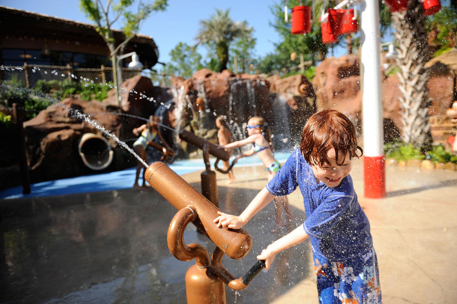 Kid Playing at Splash Pad at Disney's Animal Kingdom Lodge; Courtesy of Disney
