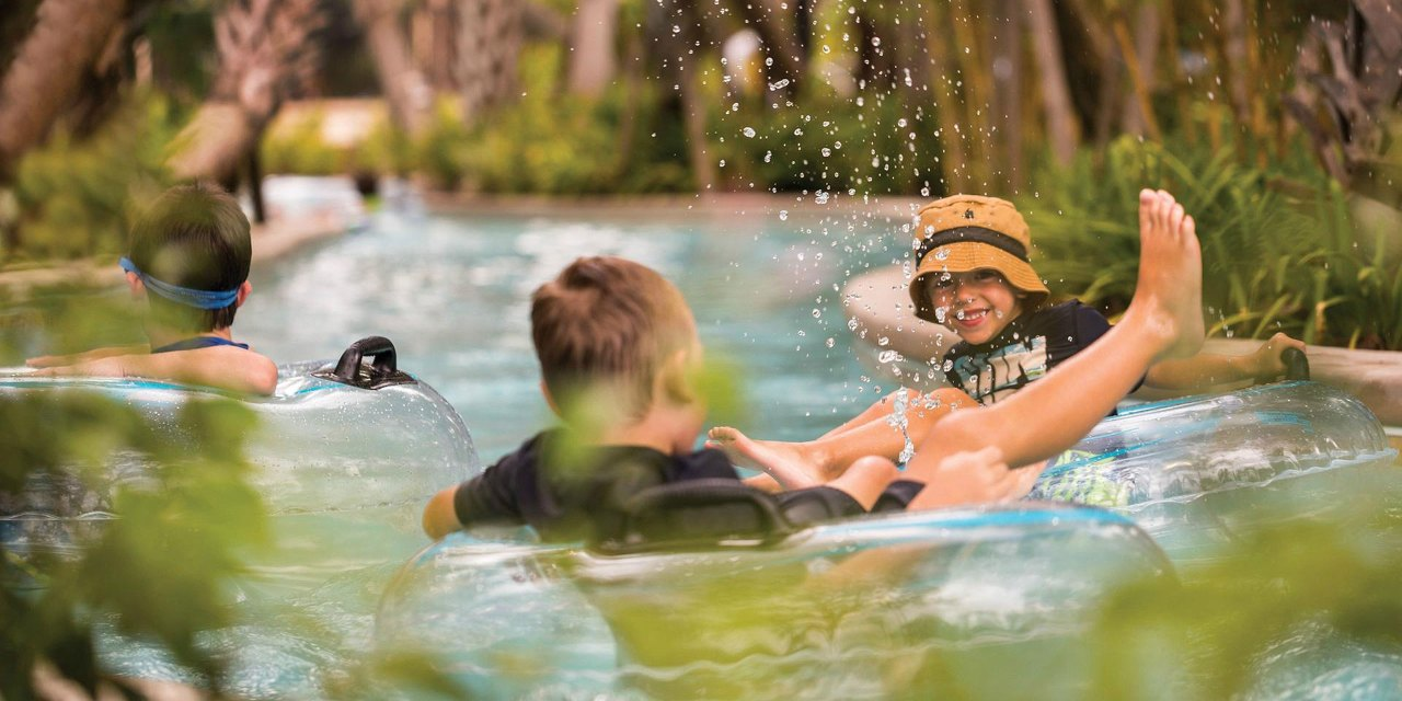 Young Boys Floating in Lazy River at Four Seasons Resort Orlando at Walt Disney World Resort; Courtesy of Four Seasons Resort Orlando at Walt Disney World Resort