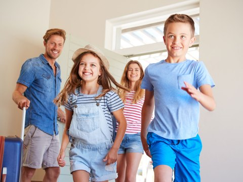 Family at Vacation Rental; Courtesy of Monkey Business Images/Shuttesrtock.com