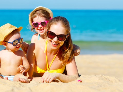 Mom and Kids on the Beach; Courtesy of Evgeny Atamanenko/Shutterstock.com