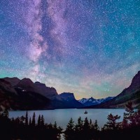 milky way above saint mary lake in glacier national park, montana, on summer night