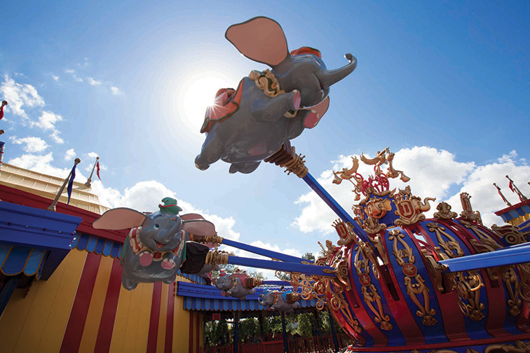 "Guests take a spin on ""Dumbo, the Flying Elephant"" at Magic Kingdom Park; Courtesy of Walt Disney World"